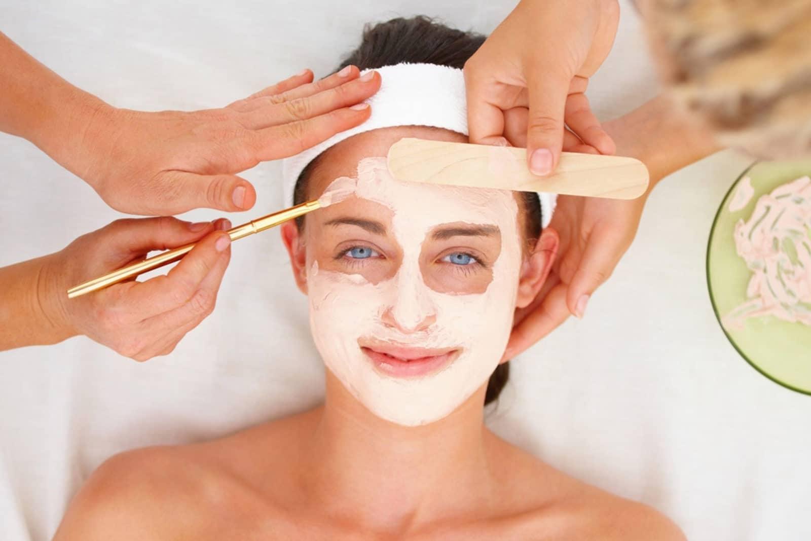 Relaxed girl receiving a facial